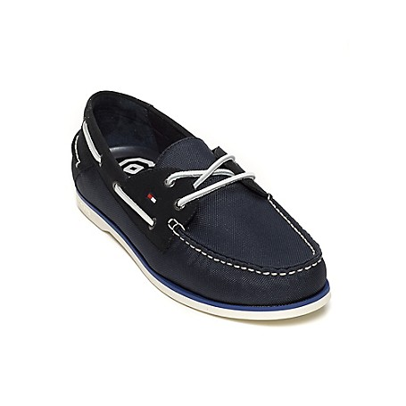 Tommy Hilfiger Canvas & Suede Deck Shoes - Midnight Tommy Hilfiger Men's Shoe. What We Do Best, The Timeless Deck Shoe In Suede And Canvas. Classic, Comfortable And Completely All-American.· Boat Shoe Silhouette In Suede And Canvas. · .75'' Heel.· Rubber Sole, Padded Insole.· Imported.