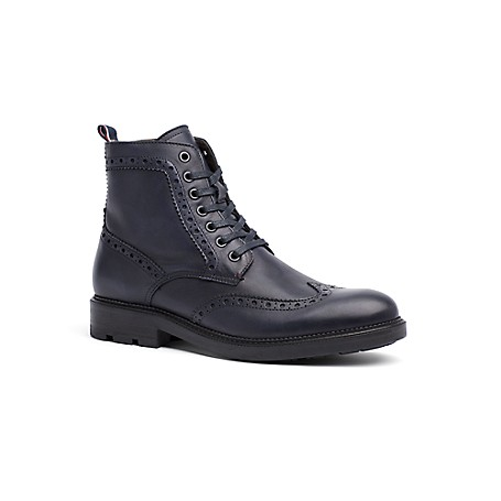 Tommy Hilfiger Tailored Collection Brogue Work Boot - Navy - 45 Tommy Hilfiger Men's Shoe. Expertly Crafted From Premium Leather In Deep Blue-Black, Our Brogue Boots Strike The Balance Between Rugged And Refined. Unexpectedly Light Yet Ruggedly Cool With A Padded Footbed, Lugged Sole And Lace-Up Vamp For A Snug Fit. Workboot Silhouette In Suede. 1.5'' Heel. Padded Footbed, Lace-Up Front, Rubber Sole. Imported.
