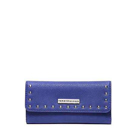Tommy Hilfiger Studded Long Wallet - Retro - Os Tommy Hilfiger Women's Wallet. This Sleek Elongated Wallet Is Distinguished By Lightly Textured, Durable Fabric That Mimics Pebbled Leather. Designed With Ample Space For Your Cards And Currency, And Made Complete With Decorative Studs And Our Signature Medallion. 100% Synthetic Fabric. 4'' (H) 8'' (L) 1'' (W) Snap Closure, Exterior Zip Pocket, Eight Card Slots, Interior Currency Pockets.  Imported.