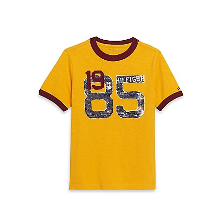 Tommy Hilfiger Final Sale- 85 Fashion Tee - Gold Yellow Tommy Hilfiger Big Boys' Tee.• Outlet Exclusive Style.• 100% Cotton.• Machine Washable.• Imported.