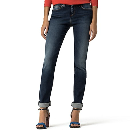 Tommy Hilfiger Vintage Wash Skinny Jeans - Absolute Blue Wash Tommy Hilfiger Women's Denim. Our Classic Skinny Jean With A Svelte Silhouette And Plenty Of Stretch To Hug The Curves Comfortably. Styled With Strategic Fading For That Coveted Lived-In Look. • Sits Lower On The Waist, Fitted Through The Hip And Thigh.• 98.5% Cotton, 1.5% Elastane.• 5-Pocket Styling. • Machine Washable. • Imported.