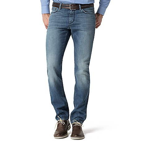 Tommy Hilfiger Straight Fit Jeans - Betalight Indigo Tommy Hilfiger Men's Jean. The Happy Medium Of Fits, Our Straight Jean Is An Ideal Compromise Between Our Classic And Slim Styles. It Sits Below The Waist With A Straight-Leg Cut To The Ankle.• 100% Cotton.• 5-Pocket Styling. • Machine Washable.• Imported.