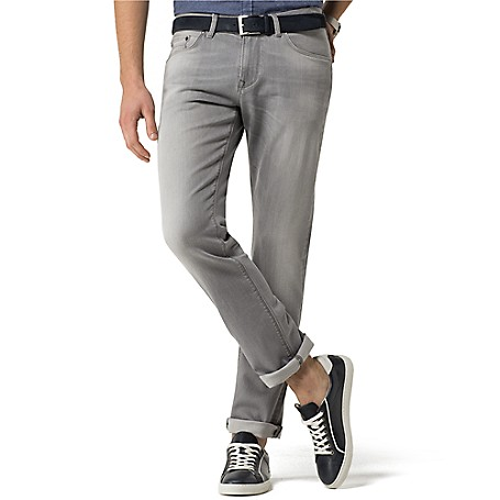 Tommy Hilfiger Grey Slim Fit Jeans - Alamar Mid Grey Tommy Hilfiger Men's Jean. Our Slimmest Jean Has Become One Of Our Best-Sellers. Styled With A Comfortable Amount Of Stretch In Stone Grey With Subtle Fading-The Alternative To Your Standard Blue Jean That Comes Off Freshly Modern. • Sits Below Waist With Narrow Leg And Low Rise.• 99% Cotton, 1% Elastane.• 5-Pocket Styling.• Machine Washable.• Imported.