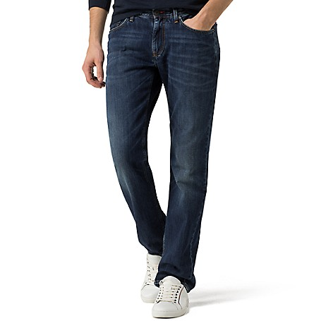Tommy Hilfiger Indigo Regular Fit Jeans - Armada Indigo Tommy Hilfiger Men's Jean. This Classic Jean Is Cut Comfortably Through The Leg And Straight From Knee To Ankle. Sitting Below The Waist, It's A Traditional Choice For Everyday.• Sits Below Waist, Straight Leg , Normal Rise. • 100% Cotton.• Five-Pocket Styling, Custom Fading.• Machine Washable. • Imported.