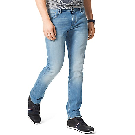 Tommy Hilfiger Slim Fit Stone Wash Jeans - Dark Blue Tommy Hilfiger Men's Jean. Our Slimmest Jean Is A Modern Choice. Styled With A Comfortable Amount Of Stretch In A Light Wash That Comes Off Vintage. • Sits Lower On The Waist, Fitted Through The Hip And Thigh With A Straight Leg. • 91% Cotton, 7% Synthetic, 2% Elastane.• 5-Pocket Styling.• Machine Washable.• Imported.