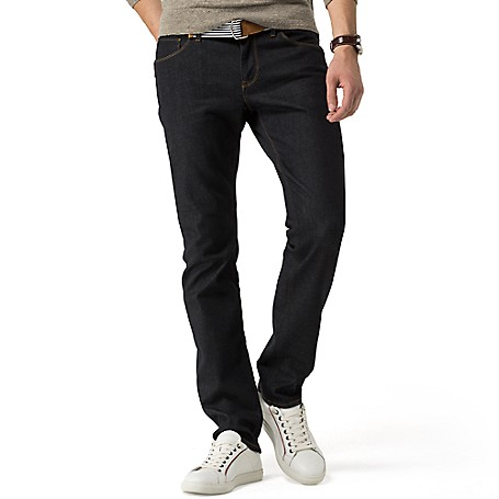 Tommy Hilfiger Slim Fit Raw Denim Jeans - Clifton Blue Tommy Hilfiger Men's Jean. Our Slimmest Jean Is A Modern Choice. Styled With A Comfortable Amount Of Stretch In A Raw Denim That Always Comes Off Polished. • Sits Lower On The Waist, Fitted Through The Hip And Thigh With A Straight Leg. • 96% Cotton, 3% Synthetic, 1% Elastane.• 5-Pocket Styling.• Machine Washable.• Imported.