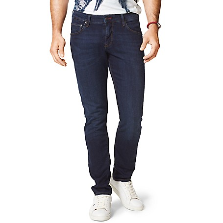Tommy Hilfiger Slim Fit Indigo Jeans - Dark Blue Tommy Hilfiger Men's Jean. Our Slimmest Jean Is A Modern Choice. Styled With A Comfortable Amount Of Stretch In A Deep Indigo Wash That Comes Off Refreshingly Modern. • Sits Lower On The Waist, Fitted Through The Hip And Thigh With A Straight Leg. • 91% Cotton, 7% Synthetic, 2% Elastane.• 5-Pocket Styling.• Machine Washable.• Imported.