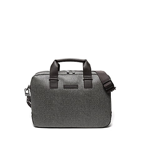 Tommy Hilfiger Uptown Laptop Bag - Grey Melange Tommy Hilfiger Men's Bag. Safely Tote Your Laptop In Our Computer Bag Designed With Double Carry Handles And A Handy Removable, Adjustable Shoulder Strap. Handsomely Styled From Durable, Easy-Care Material That Mimics The Appearance Of Tweed. Laptop Bag Silhouette In Pvc. 12.5'' (H) X 16'' (L) X 3.5'' (W), 4.5'' Drop. Zip Closure, External Sleeve Pocket, Interior Pockets, Lined, Adjustable Shoulder Strap. Spot Clean. Imported.