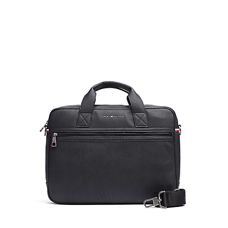 Tommy Hilfiger Commuter Laptop Bag - Black Tommy Hilfiger Men's Bag. Safely Tote Your Laptop In Our Computer Bag Designed With Double Carry Handles. Styled In Durable Fabric To Outlast The Daily Grind And Featuring A Genius Exterior Pocket That Zips Opens At The Bottom, Allowing The Bag To Slide Over The Handle Of Your Upright Suitcase. Laptop Bag Silhouette In Nylon. 12'' (H) 3.5'' (L) 15.7'' (W) Zip Closure, External Pocket, Interior Pockets, Lined. Spot Clean. Imported.
