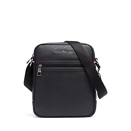 Tommy Hilfiger City Camera Bag - Black - Os Tommy Hilfiger Men's Bag. For The Urbanite On The Go With Minimalist Needs, Our Camera Bag Is The Compact Solution For Toting The Essentials. Camera Bag Silhouette In Synthetic Material With Metal Hardware. 11'' (H) 9 (L) 2'' (W)  Zip Closure And External Pocket, Interior Pockets, Adjustable Shoulder Strap. Spot Clean. Imported.