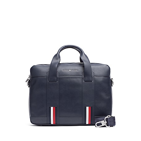 Tommy Hilfiger Th Stripe Laptop Bag - Tommy Navy / Corporate - Os Tommy Hilfiger Men's Bag. Safely Tote Your Laptop In Our Stripe Computer Bag Designed With Double Carry Handles. Styled In Durable Material To Outlast The Daily Grind And Featuring A Genius Exterior Pocket That Zips Opens At The Bottom, Allowing The Bag To Slide Over The Handle Of Your Upright Suitcase. Laptop Bag Silhouette In Synthetic Fabric. 12'' (H) 16'' (L) 4'' (W) Zip Closure, Interior Pockets, Lined. Spot Clean. Imported.