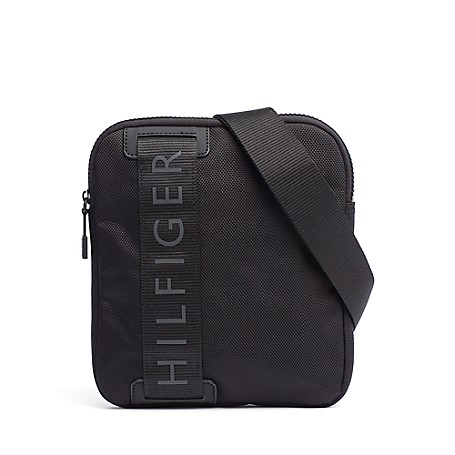 Tommy Hilfiger Signature Camera Bag - Black - Os Tommy Hilfiger Men's Bag. For The Urbanite On The Go With Minimalist Needs, Our Camera Bag Is The Compact Solution For Toting The Essentials. Camera Bag Silhouette In Synthetic Material. 9'' (H) 8 (L) 1'' (W)  Zip Closure, Interior Pockets, Adjustable Shoulder Strap. Spot Clean. Imported.