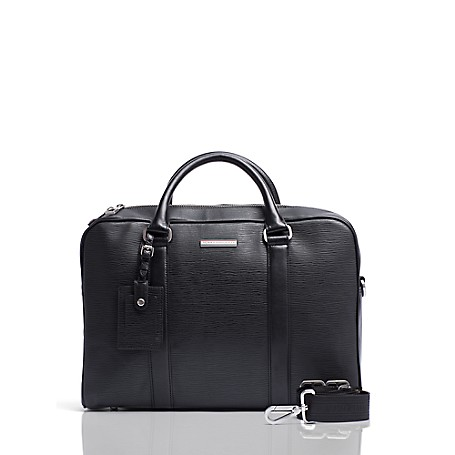 Tommy Hilfiger Leather Laptop Bag - Black Tommy Hilfiger Men's Bag. Form And Function Merge In Our Computer Bag Designed To Safely (And Handsomely) Tote Your Laptop. Perfect On The Go With Double Carry Handles And A Handy Removable, Adjustable Shoulder Strap.  Satchel Silhouette In Leather With Silver-Tone Hardware. 12'' (H) 16'' (L) 3.5'' (W)  Zip Closure, Base Cleats, Interior Pockets, Lined, Removable Adjustable Shoulder Strap Included.  Spot Clean. Imported.