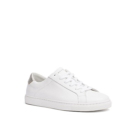 Tommy Hilfiger White Leather Court Shoes - White - 37 Tommy Hilfiger Women's Shoe. No Longer Reserved For The Court, The White Sneaker Is Back And Works With Everything From Vintage Jeans To Floral Dresses.  100% Leather. 1'' Heel.  Cushioned Insole, Textured Rubber Outsole.  Spot Clean.  Imported.
