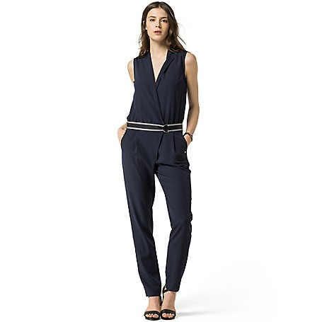 Tommy Hilfiger Work & Playsuit - Navy Blazer - 2 Tommy Hilfiger Women's Jumpsuit. A One-Piece Wonder That Works From 9-5 And Beyond--We're Fans Of The Jumpsuit For Its Chic And Easy Style. Sleeveless Blazer Styling Is Tied Together By A Grosgrain Belt That You Can Remove For A More Modern, Evening Look. The Trouser Portion Features A Diagonal Placket Fastened By A Single Button And Hook And Eye-Closure. To Keep Things Laid-Back, We Finished The Look With Hip Pockets.      Classic Fit.  100% Synthetic.  Slash Pockets, Removable D-Ring Belt, Chest Snap Closure.  Machine Washable. Imported.