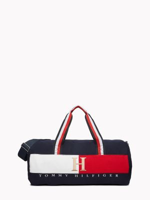 Men\\\'s Classic Duffle Bag, Navy/White/Red, - Tommy Hilfiger men\\\'s bag. Our duffle features an adjustable shoulder strap for easy toting and is lined to keep your gear dry. Built to last, it\\\'s durable enough to take anything you throw at it (or in it).