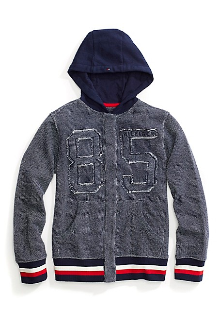 Tommy Hilfiger Boys' Sweatshirt. This Sporty Hoodie Is Loaded With Cool Details-Like Our Team Number Emblazoned Across The Chest And Signature Stripe Detail. Our Favorite Part? A Warm Hood Lined In Cozy Faux Fur. Thanks To Hidden Magnet Closures Along The Front, Dressing Will Be A Breeze. Part Of Our Adaptive Collection, Designed For Ease Of Dressing In Classic Tommy Style. 64% Cotton, 36% Synthetic. Ribbed Cuffs And Hem, Lined Hood, Split Kanga Pocket. Magnetic Front Designed To Appear As Traditional Seam. Close All Fasteners Prior To Wash. Machine Wash Warm. Tumble Dry Gentle Cycle. Do Not Iron Magnets. Additional Care Instructions May Be Found On The Garment. Magnets Are Safety Tested. If You Have A Pacemaker, Consult Your Physician Before Using Our Products. Imported.