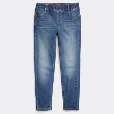 Girl\\\'s Seated Fit Skinny Jean, Toni Wash, - Tommy Hilfiger girls\\\' jean. Our skinny jeans are not just cool, extra stretch makes them totally comfortable too. Thoughtfully designed for seated wear with a lower front rise to reduce unwieldy fabric bunching, and a higher back rise absent of pockets and seams for a smoother, more comfortable fit. Even better? To keep the dressing easy, we swapped out a traditional zip fly for a comfortable, full elastic waist. Part of our Adaptive Collection, designed for ease of dressing in classic Tommy style.