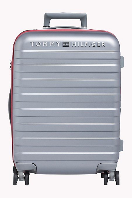 "Tommy Hilfiger Luggage. Our Durable Upright Roller Stands Out On The Carousel From A Sea Black Bags. Constructed Of Durable Lightweight Polycarbonate Ready To Take On The Rigors Of Travel. Four Multi-Directional Spinner Wheels Provide Effortless Rolling To Make Traveling A Breeze. 20 (H) X 14"" (L) X 9"" (W) Sized To Comply With Most Domestic Airline Carry-On Rules. Aluminum Locking Handle, Top And Side Carry Handle, Lined. 10-Year Limited Manufacturer's Warranty. Imported. Ground Shipping Only. Not Eligible For Shoprunner Free 2-Day Shipping."""