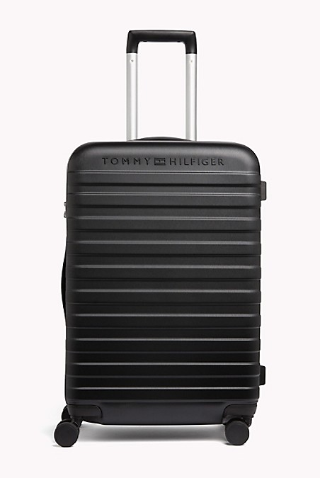 "Tommy Hilfiger Luggage. Our Upright Roller Stands Out On The Carousel From A Sea Black Bags. Constructed Of Durable Lightweight Polycarbonate Ready To Take On The Rigors Of Travel. Four Multi-Directional Spinner Wheels Provide Effortless Rolling To Make Traveling A Breeze. 24 (H) X 17"" (L) X 11"" (W) Aluminum Locking Handle, Top And Side Carry Handle, Lined. 10-Year Limited Manufacturer's Warranty. Imported. Ground Shipping Only. Not Eligible For Shoprunner Free 2-Day Shipping."""