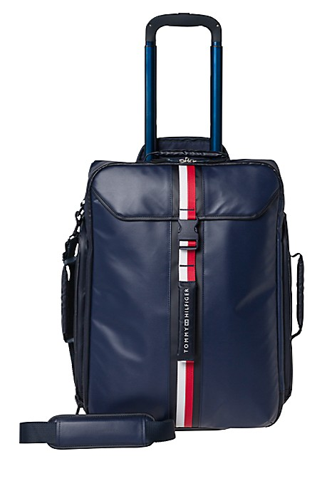 "Tommy Hilfiger Luggage. Functional And Stylish, Our Sporty Spin On The Suitcase Will Be Your Favorite New Traveling Comapnion. Featuring A Telescopic Handle And Wheels To Make Traveling A Breeze. Designed In Durable Nylon To Withstand The Rigors Of Travel And Sized To Stow Inside The Overhead Compartment. Synthetic Material With Metal Hardware. 21 (H) 14.5"" (L) 8"" (W) Aluminum Locking Handle, Top And Side Carry Handle, Lined, External Pocket. 10-Year Limited Manufacturer's Warranty. Imported. Ground Shipping Only. Not Eligible For Shoprunner Free 2-Day Shipping."""