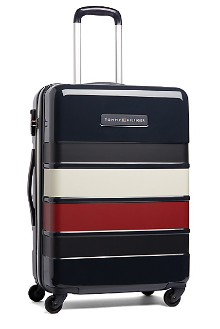 "Tommy Hilfiger Luggage. Our Durable 24 Upright Roller Suitcase Stands Out On The Carousel In Bold Stripes. Constructed Of Durable Lightweight Polycarbonate Ready To Take On The Rigors Of Travel. Four Multi-Directional Spinner Wheels Provide Effortless Rolling To Make Traveling A Breeze. 18"" (L) X 26"" (W) 10"" (H) 9.03 Pounds. Aluminum Locking Handle, Top And Side Carry Handle, Lined. 10-Year Limited Manufacturer's Warranty. Imported. Ground Shipping Only. Not Eligible For Shoprunner Free 2-Day Shipping."""