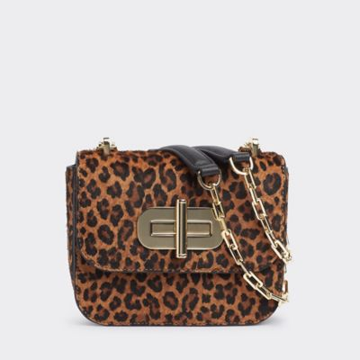 Women\\\'s Leopard Turnlock Crossbody, Cheetah, - Tommy Hilfiger women\\\'s bag. Our leopard print leather crossbody features our signature turnlock closure, and a chain and leather shoulder strap. It\\\'s a chic look that transitions from day to night with ease.